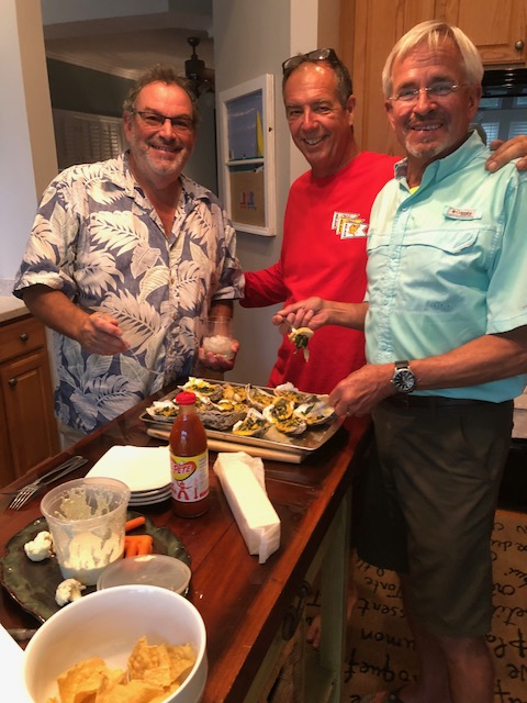 Three oyster shuckers